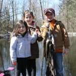 Tori and Tessa Rancourt, ages 4 and 6, and Daniel Cronk, age 7, all of Pleasant Valley, caught 14 trout.