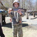 "Sam Niznik, age 9 of Pleasant Valley a 16"" trout."
