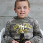 "Giovanni Abbati, age 5 won a trophy for his catch, a 16 1/2 "" trout."
