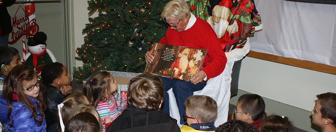 Penny Hickman Reads to Children